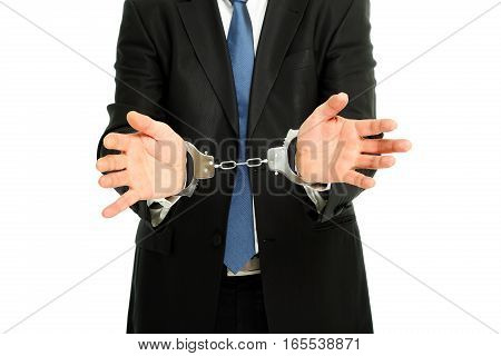man in suit with handcuffs on white