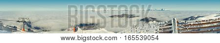 Panoramic Scenery From The Top Of A Slope Covered By Heavy Snow On A Sunny Winter Day After A Blizza