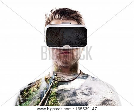 Double exposure. Hipster man wearing virtual reality goggles. Country road leading through forest. Isolated.