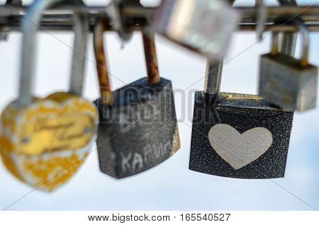 Wedding locks. Bunch of padlocks with inscriptions and ornaments.