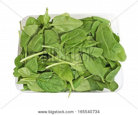 Box of organic fresh spinach on a white background