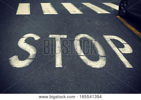 City crosswalk with symbol stop closeup road texture background