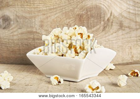 Bowl Full Of Popcorn On Wooden Background