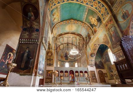 MTSKHETA, GEORGIA - OCT 13, 2016: Interior of old church with sanctuary and frescoes at the Shio-Mgvime monastery on October 13, 2016. Christian monastery built in 6th century