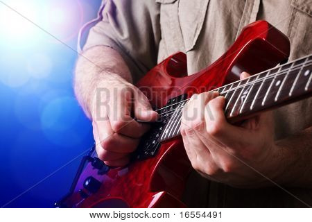 A rock lead guitarist  in action on stage