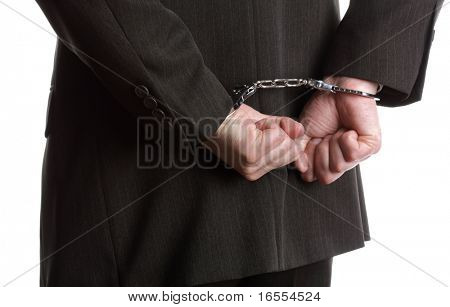 Concept for corporate crime, businessman wearing handcuffs