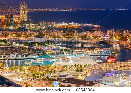 View of the sea passenger port in Barcelona at night.