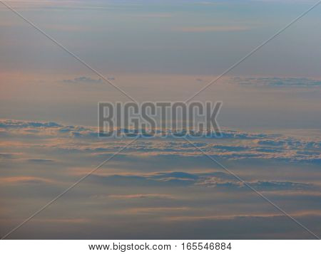 the sky above the clouds in the evening