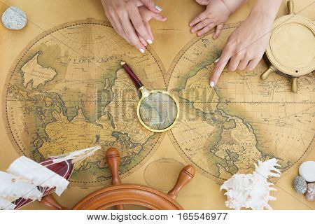 Antique Map Of The World With Steering Wheel And Shell