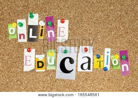 Online education e-learning concept on cork board