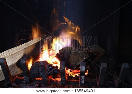 Fire with wood logs in a chimney