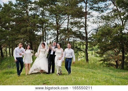 Funny And Happy Wedding Couple With Bridesmaids And Best Mans.