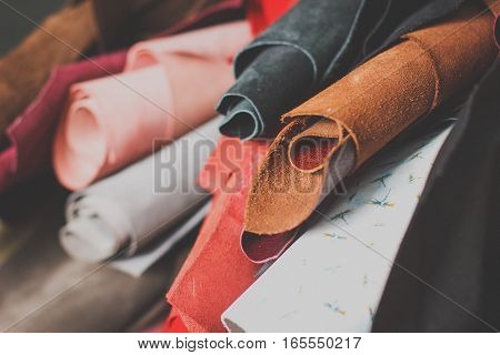 Leather craft . Selected pieces of beautifully colored or tanned leather