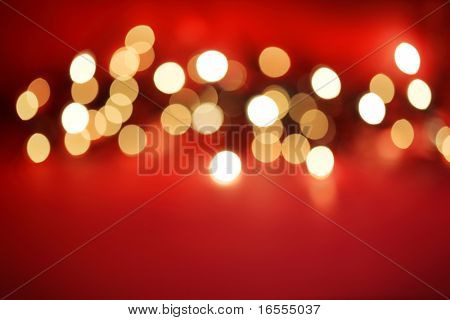 Abstract blurred white lights on red background