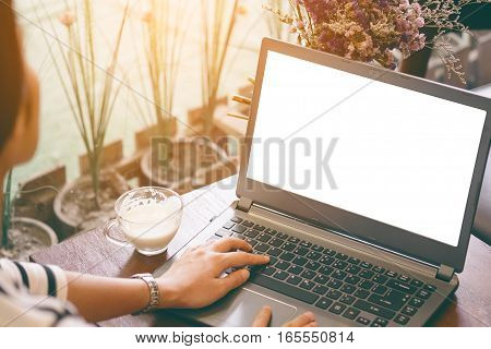 Beautiful hipster asian woman using laptop at cafe in vintage tone