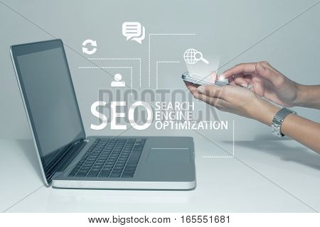Search engine optimization SEO business concept with laptop