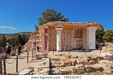CRETE, GREECE - OCTOBER 21, 2008: Unidentified tourists near South Propylaeon at the Knossos palace on the Crete island in Greece. Knossos is the largest Bronze Age archaeological site on Crete and is Europe's oldest city