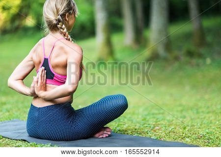 Yoga Reverse Prayer Position, toned image, outdoors