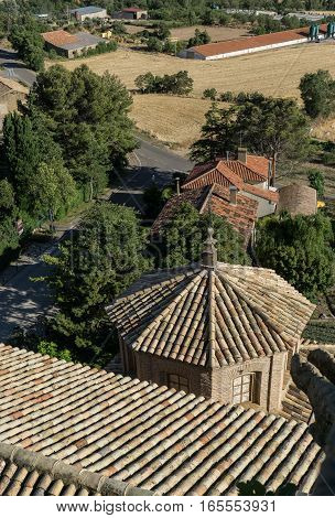 Aerial view of Shingle roof tile of chapel and Church of San Esteban built in the 18th century, Loarre Aragon Huesca Spain, and the road to the village