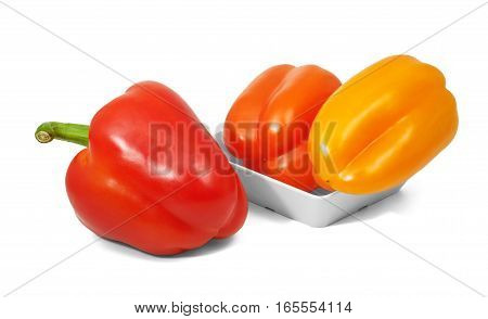 Red and orange bell pepers in horizontal position on white background