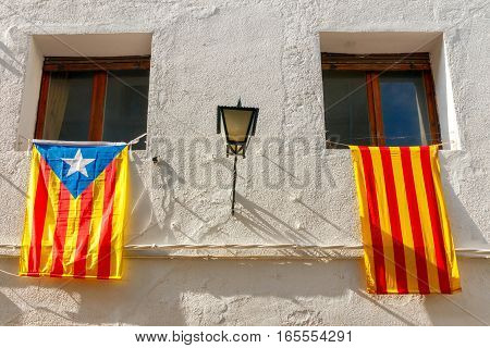 Flag movement for the independence of Catalonia, on a street in the city center of Tossa de Mar. Costa Brava, Catalonia, Spain.