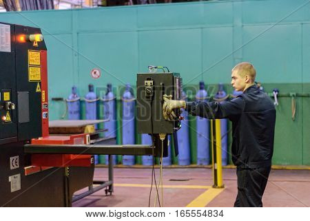 Tyumen, Russia - November 14, 2007: JSC Tyumenskie Motorostroiteli. Plant on production and repair of aviation engines. Technician operates computerized metalworking machine