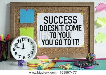 Success concept with motivational quote in office
