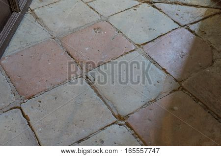 Clay floor tiles, very old probably from the 18th century. Timeworn