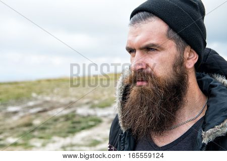 Man Hipster Traveler With Beard And Moustache Portrait On Mountain