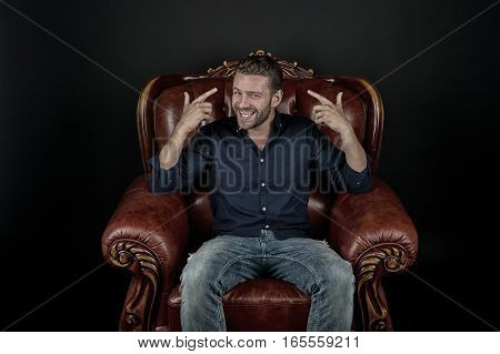 Happy Bearded Man In Leather Chair