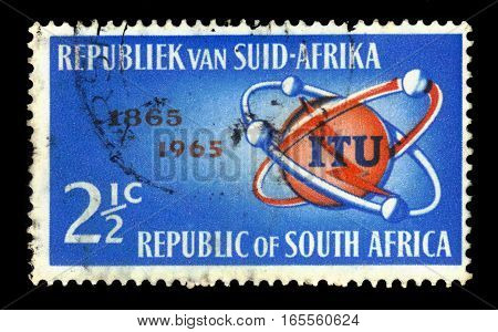 South Africa - CIRCA 1965: A stamp printed by South Africa shows emblem of I.T.U. (International Telecommunication Union), series century, circa 1965