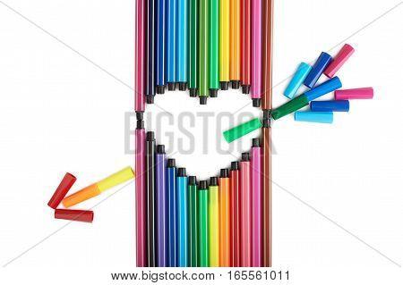 Heart of felt tip pens on a white background