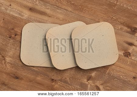 Vintage coasters. Isolated on wooden background. Include clipping path. 3d render