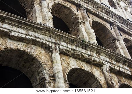 Close-up view of ancient archs of the Roman Coliseum in Rome Italy