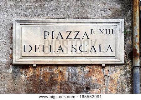 Piazza Della Scala, street plate on a wall of old house in Trastevere district, Rome, Italy