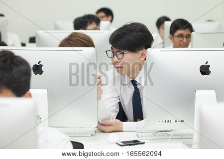 Bangkok, Thailand - November 17, 2015 :  King Mongkut's Institute of Technology Ladkrabang is a research and educational institution in Thailand. A class of students in front of their screens study computer science.