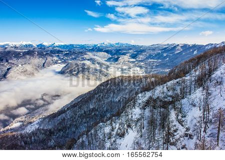 Beautiful Lake Bohinj surrounded by mountains with snow of Triglav national park. Winter view from Vogel cable car top station Slovenia