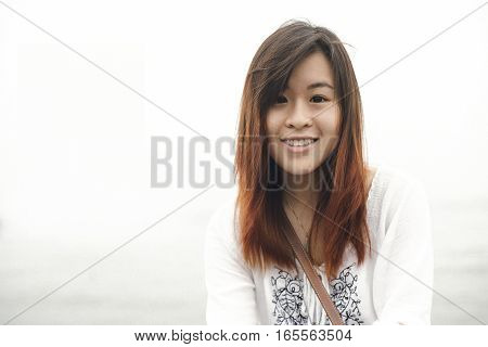Portrait of Young Asian Woman at outdoor light in vintage tone style.