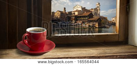 coffee on table and Venice in sunset time, Italy.