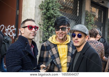 MILAN ITALY - JANUARY 15: Fashionable people gather outside Damir Doma fashion show building during Milan Men's Fashion Week on JANUARY 15 2017 in Milan.