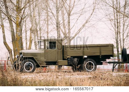 World War II Old Russian soviet army military truck ZIS-5 outdoor in autumn forest