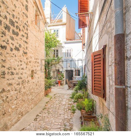 Narrow street and old houses in old town in Cres, Croatia, Mediterranean ambient