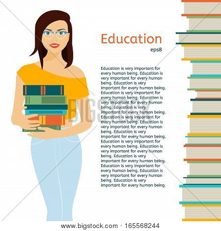 Girl in eyeglasses standing on a white background and holds a stack of books