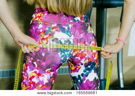 Fit Woman Measuring Buttocks