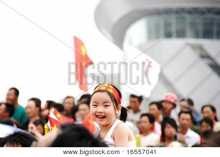 Inner Mongolia,China - JULY 10:  A cute girl among celebrating crowd during the olympic torch relay for the Beijing 2008 olympic games (August 8, 2008) in Inner Mongolia, China on July 10.