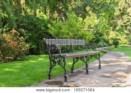 Beautiful wrought iron bench in the Park Paradise. Partenit Crimea Russia