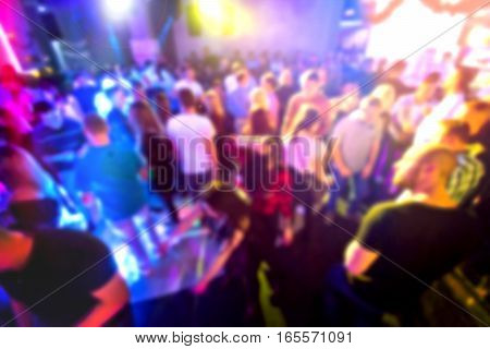 Crowd of people on the club party. Motion blurred picture.