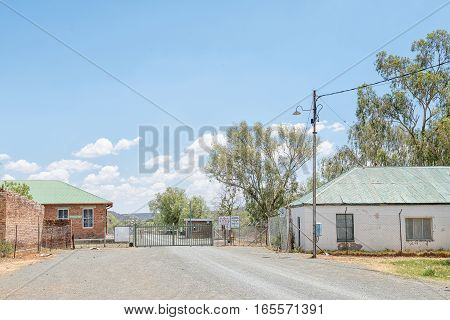 JAGERSFONTEIN SOUTH AFRICA - DECEMBER 31 2016: Entrance to the Jagersfontein diamond mine. The town claims the title of oldest mining town in South Africa and biggest hand dug hole in the world