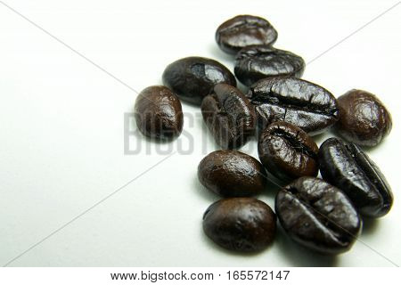 Macro of Coffee Beans on white background Dark Roasted Coffee Bean, Cafe, Coffee Crop, Cut Out
