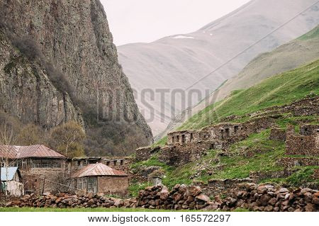 Old Empty Abandoned Village With Dilapidated Houses In Truso Gorge, Kazbegi District, Mtskheta-Mtianeti Region, Georgia. Spring Or Summer Season